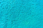 Fotografie close-up view of bright blue weathered wall texture