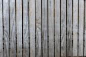Dlažební kámen šedý dřevěný plot pozadí
