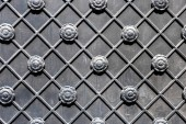 close-up view of decorative black metal gate background
