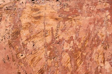 close-up view of brown scratched weathered rough wall texture