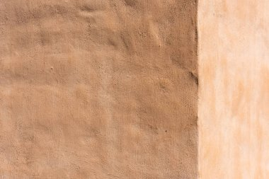 empty light brown cement wall background