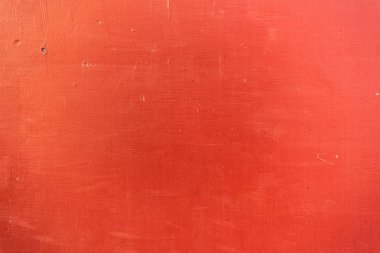 close-up view of bright red scratched textured background