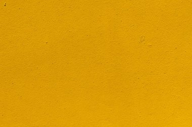 Close-up view of yellow weathered rough wall texture stock vector