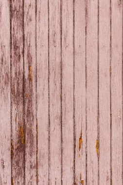 old scratched brown wooden fence background with vertical planks