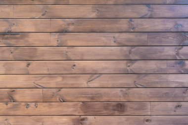 close-up view of brown hardwood background with horizontal planks
