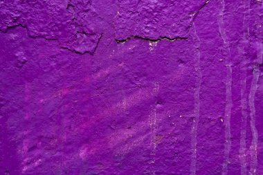 close-up view of weathered purple wall background