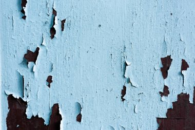 close-up view of old scratched blue weathered wooden background