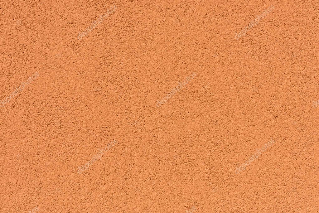 close-up view of orange rough weathered background