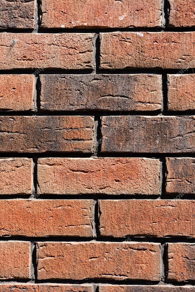 close-up view of brown weathered brick wall background