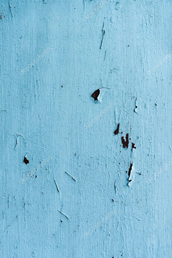 close-up view of old scratched blue wall background
