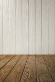 Photo brown striped tabletop and white wooden wall