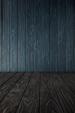 grey wooden table and dark blue wooden wall