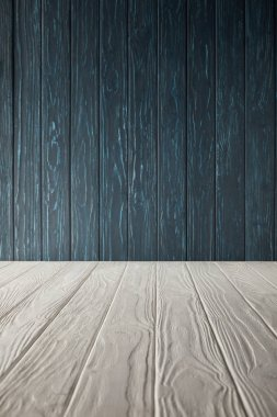 white wooden table and dark blue wooden wall