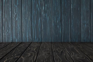 dark grey wooden table and dark blue wooden wall