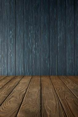brown wooden table and dark blue wooden wall