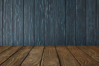brown striped tabletop and dark blue wooden wall