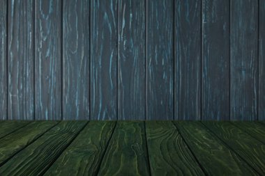 green striped tabletop and dark blue wooden wall