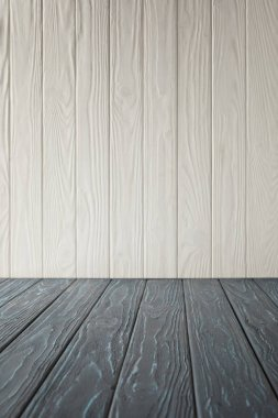 grey striped tabletop and white wooden wall