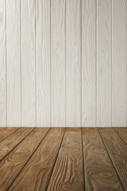 brown striped tabletop and white wooden wall