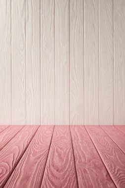 pink striped tabletop and white wooden wall