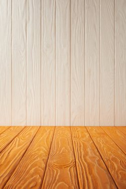 orange striped tabletop and white wooden wall