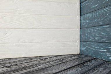 grey wooden floor and different wooden walls