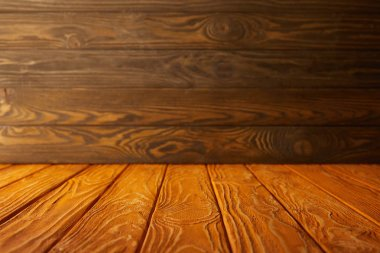 orange striped tabletop and brown wooden wall
