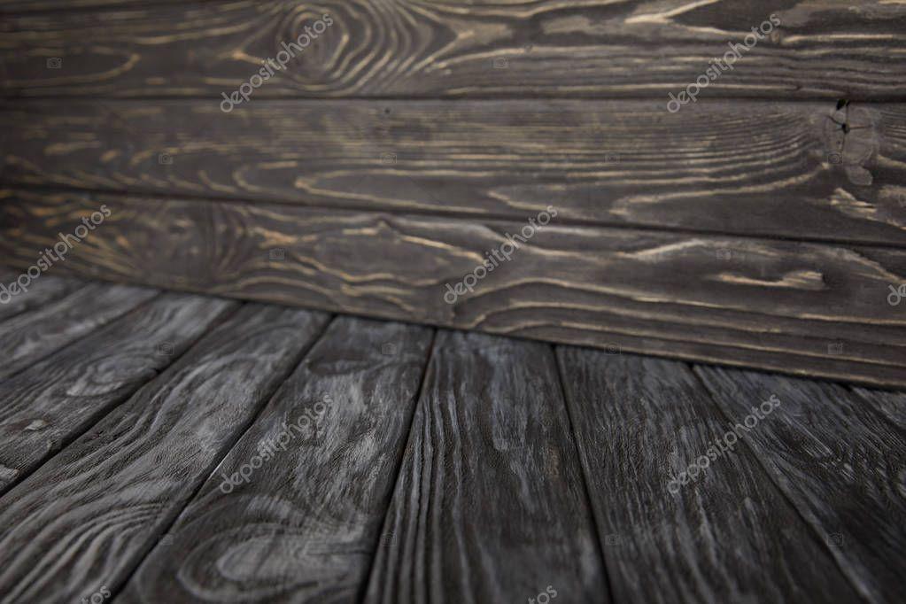 dark grey wooden floor and dark brown wooden wall
