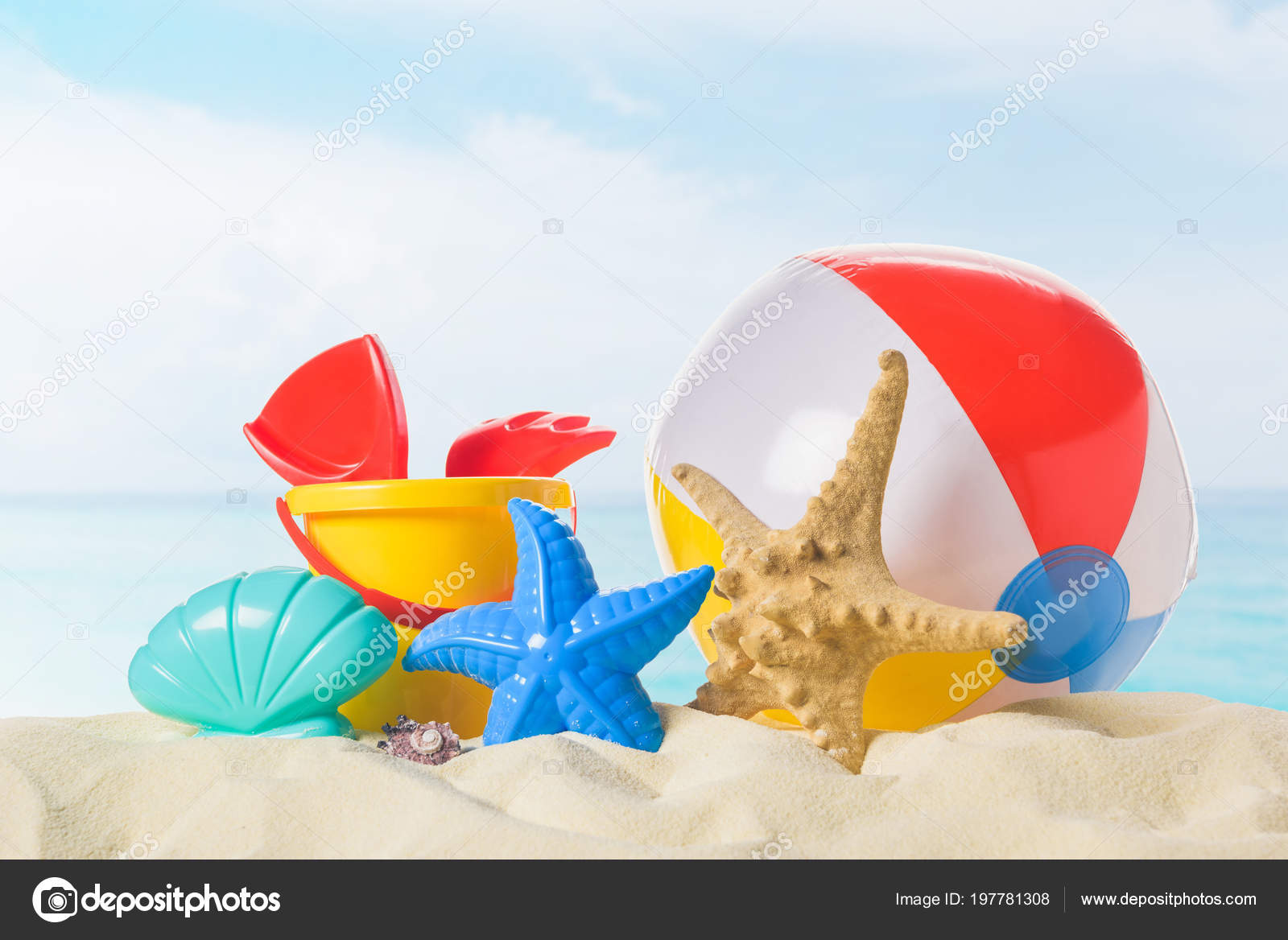 Beach ball in sand Ocean Beach Ball And Toys In Sand On Blue Sky Background Stock Image Depositphotos Beach Ball Toys Sand Blue Sky Background Stock Photo Micenin