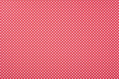 Texture of polka dot pattern on red background stock vector