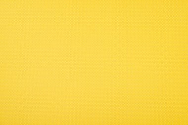 Texture of polka dot pattern on yellow background