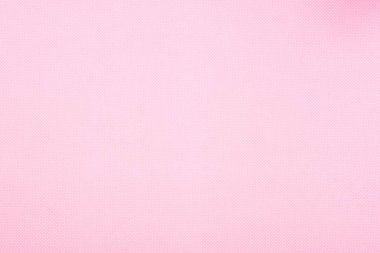 Texture of polka dot pattern on pink background