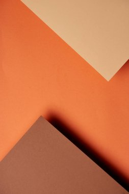 Paper sheets in brown and orange tones background