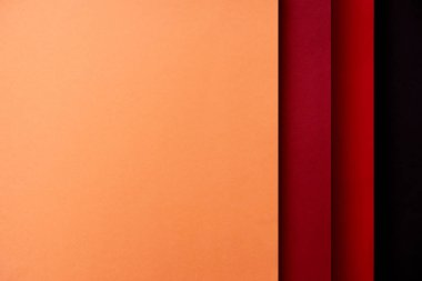 Abstract background with paper sheets in red and orange tones