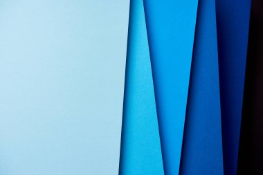 Abstract background with paper sheets in blue tones