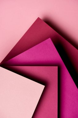 Abstract background with paper sheets in magenta tones