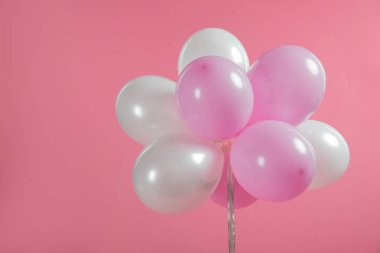 Pink and white party balloons isolated on pink stock vector