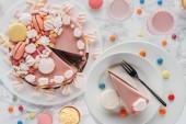 top view of birthday cake, candies, sweet cupcakes and milkshake in glasses on table