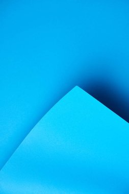 close-up view of beautiful bright blue abstract paper background