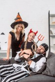 Fotografie portrait of family in halloween costumes at home