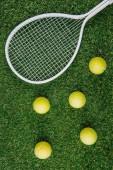 top view of tennis equipment of green grass