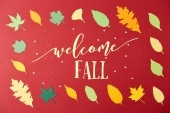 Fotografie frame made of colorful papercrafted leaves with welcome fall lettering on red background