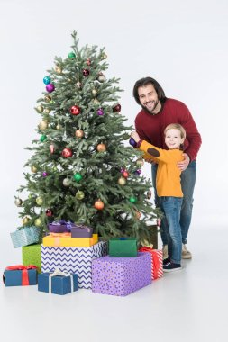 Happy father with son decorating christmas tree with presents isolated on white stock vector