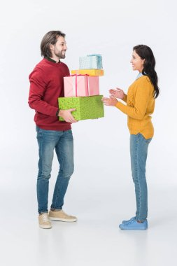 Happy husband presenting wrapped gifts to wife isolated on white stock vector