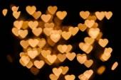 zlaté srdce bokeh světla na černém pozadí