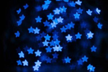 beautiful blue stars bokeh on black background