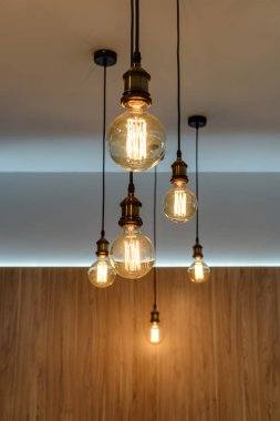 close-up view of illuminated light bulbs hanging in empty room