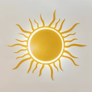 close-up view of decorative bright yellow sun isolated on white