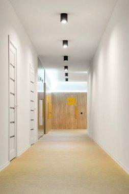 Empty hallway with doors and lamps in kindergarten stock vector