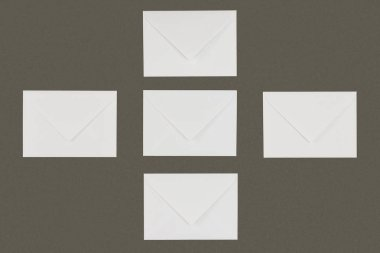 Top view of white envelopes arranged isolated on grey background stock vector